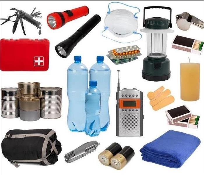 Emergency kit supplies: water bottle, matches, rope, flashlight, blanket